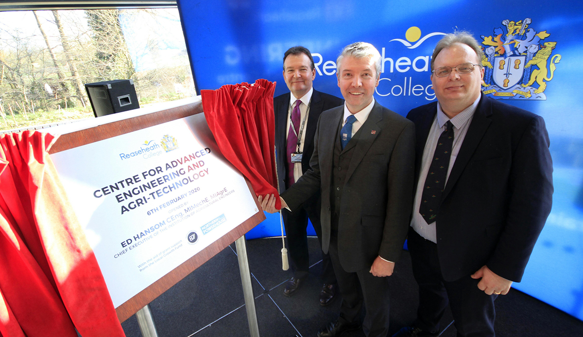Ed Hansom, CEO of the Institution of Agricultural Engineers, officially opens Reaseheath's Centre for Advanced Engineering and Agri Technology watched by Marcus Clinton and David Pearson